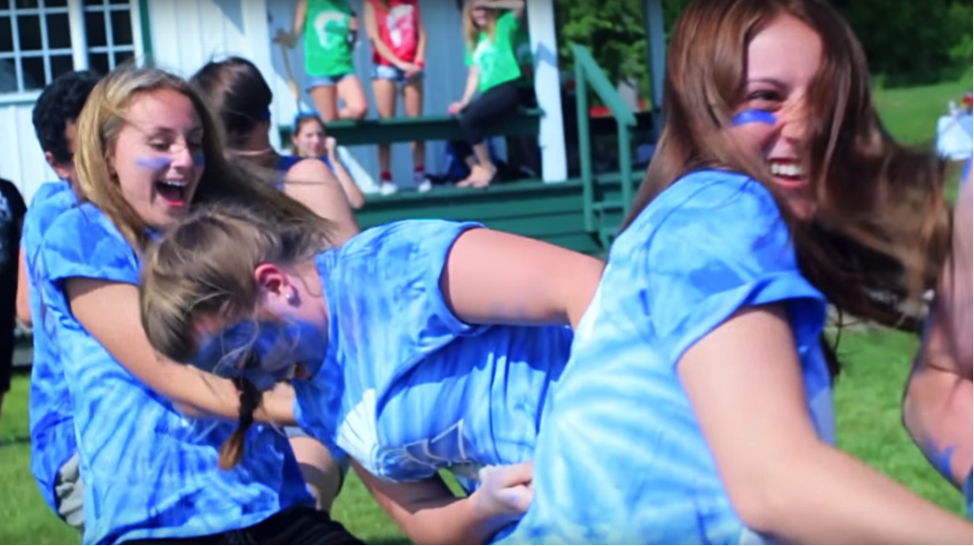 Students at LCS (including Allie Avard, centre) work together at a school spirit event