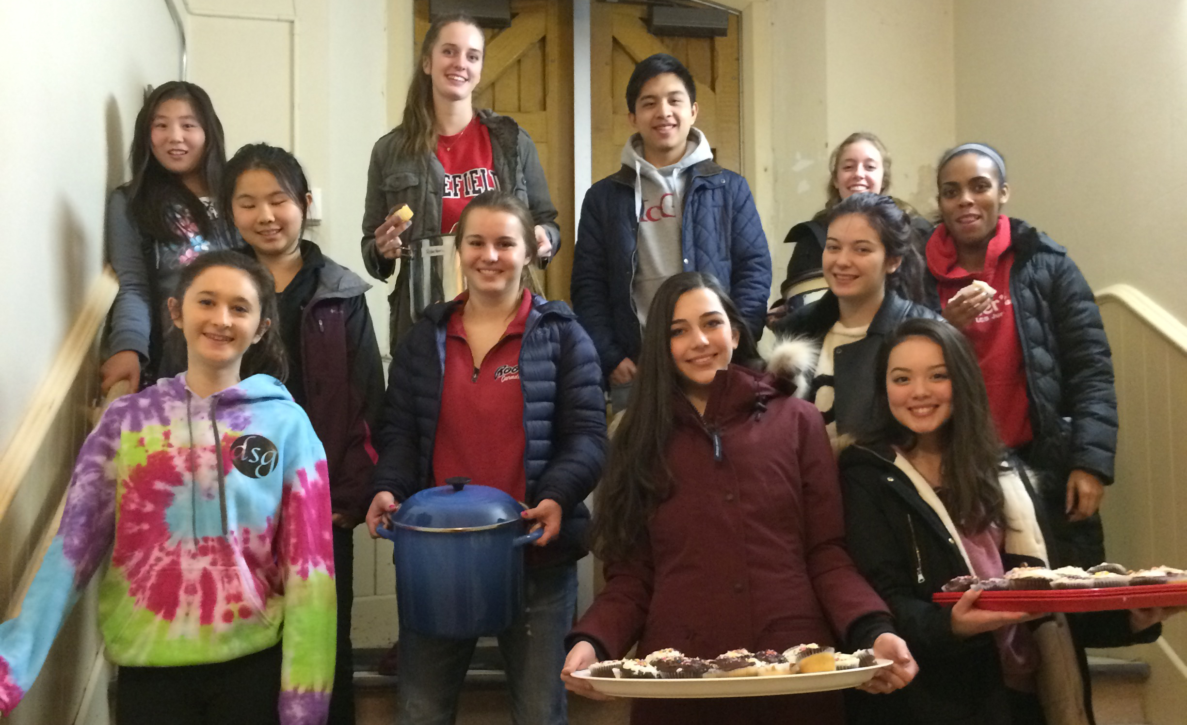 LCS students gather food for those in need while volunteering for the local initiative, Out of the Cold.