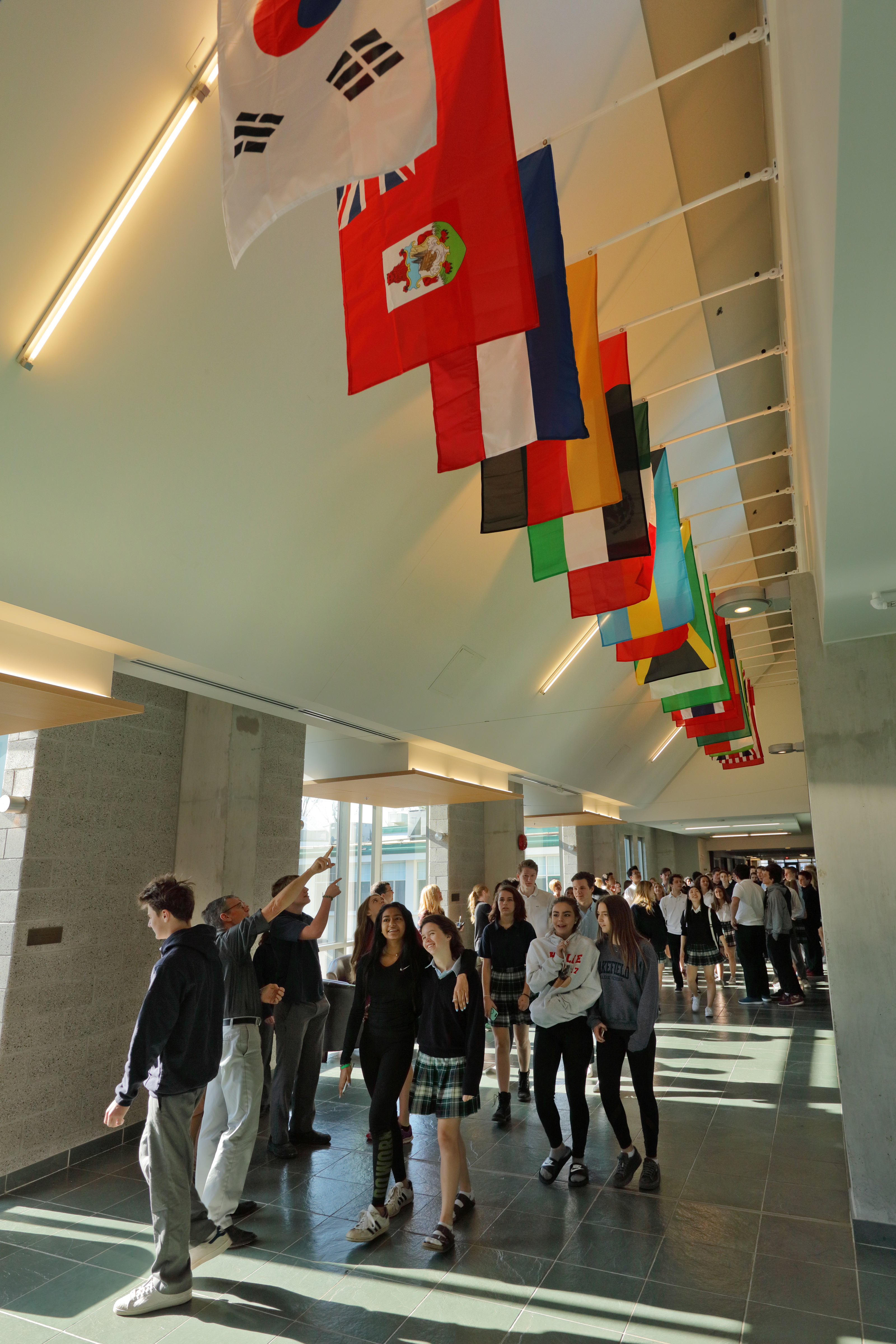 Flags in the Hall of Nations celebrate different cultures