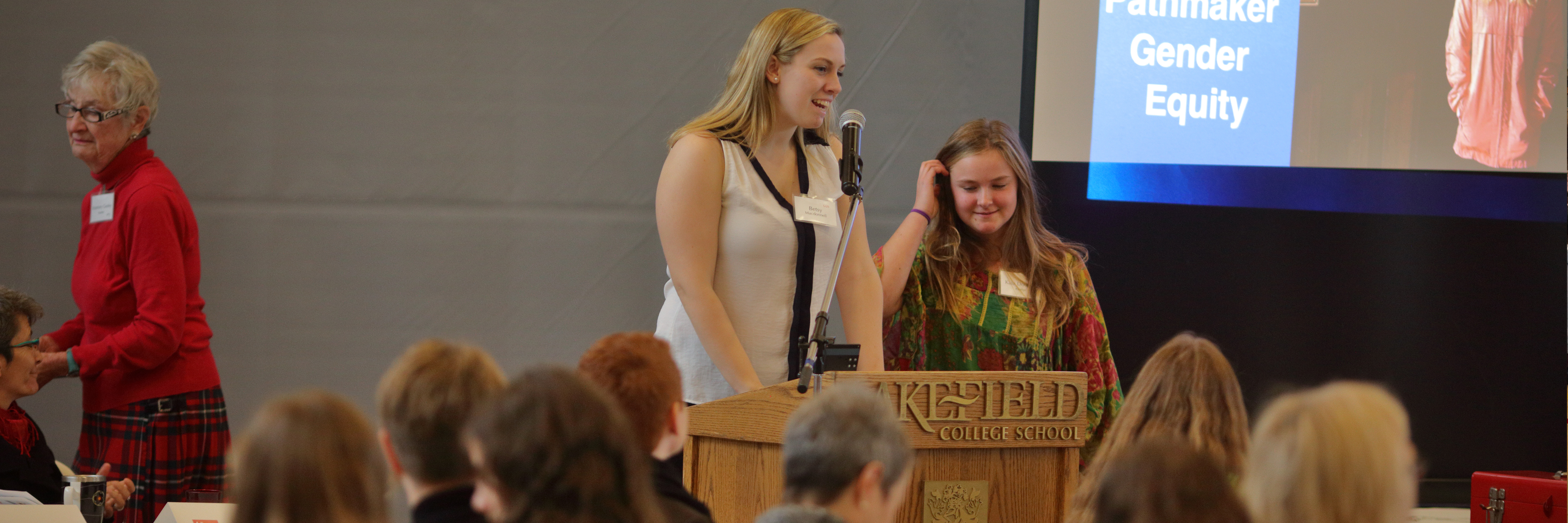 MC Betsy Macdonnel introducing Pathmaker Kaia Douglas